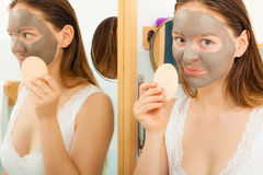 Woman face with mud facial mask Royalty Free Stock Photography