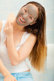 Woman face with mud facial mask Royalty Free Stock Image