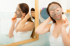 Woman face with mud facial mask Royalty Free Stock Photos