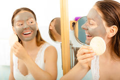 Woman face with mud facial mask Stock Image