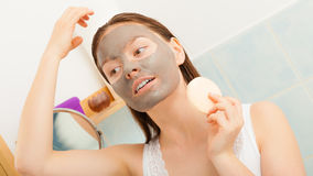 Woman face with mud facial mask Royalty Free Stock Images