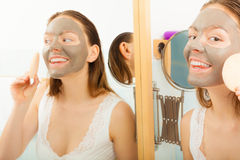 Woman face with mud facial mask Stock Photography