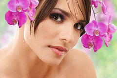 Woman face with orchid flowers Stock Image