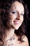 Woman face with paint close-up portrait Stock Photo