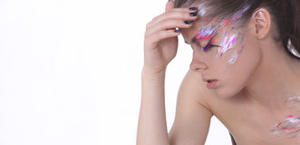Woman with face paint Stock Images