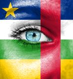 Woman face painted with flag of Central African Republic stock photo