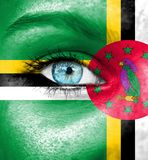 Woman face painted with flag of Dominica royalty free stock photos