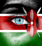 Woman face painted with flag of Kenya royalty free stock photo