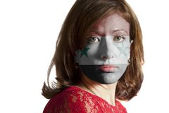 Woman face with painted Flag of Syria stock image