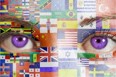 Woman face with painted flags all countries of world. Close up stock photography