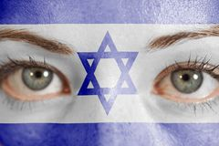 Woman face painted with Israel Flag. Closeup stock images