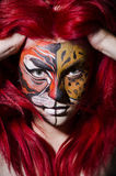 Woman with face painting. In dark room royalty free stock image