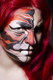 Woman with face painting Royalty Free Stock Image