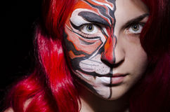 Woman with face painting. In dark room Stock Images
