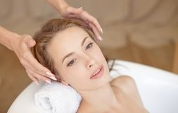 Woman face with perfect skin doing facial massage in a bathtub royalty free stock image