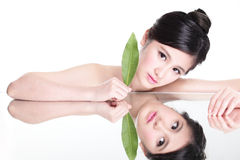 Woman face portrait with green leaf Stock Photo