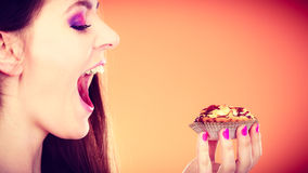 Woman face profile holds cake in hand royalty free stock image