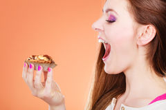 Woman face profile holds cake in hand stock photos