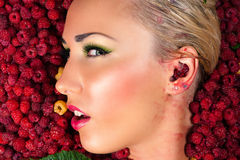 Woman face in profile raspberry closeup Royalty Free Stock Images