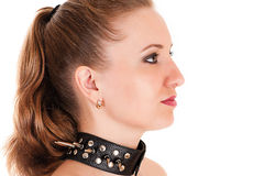 Woman face profile with spiked collar Royalty Free Stock Image