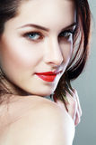 Woman face with red lips. Beautiful woman face with red lips and chic glamour make-up close up Stock Photo