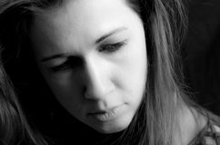 Woman Face Serious. A close up on a woman's face in black and white Stock Image