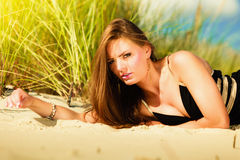 Woman face sunbathing on beach. Stock Photo