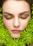 Woman face surrounded flowers Stock Photos
