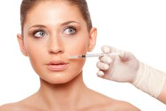 Woman face and syringe Royalty Free Stock Image