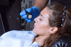 Woman face treatment at medical center Stock Images