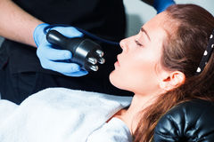 Woman face treatment at spa center Royalty Free Stock Photo
