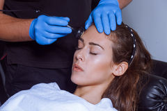 Woman face treatment at spa center Royalty Free Stock Image