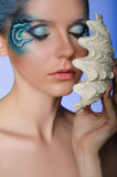 Woman in the face-up mermaid Stock Photos