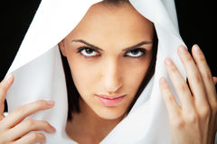 Woman face with veil Stock Images