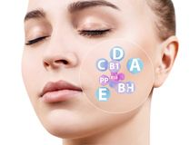 Woman face with vitamins icons. Healthy skin concept. Isolated on white stock image