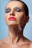Woman face in water Stock Images