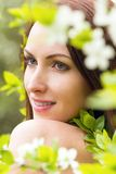 Woman face with white blossom flowers Royalty Free Stock Images