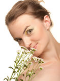 Woman face with white flowers Royalty Free Stock Image