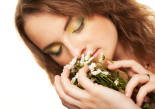 Woman face with white flowers Stock Photography