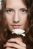 Woman face with white flowers Royalty Free Stock Images