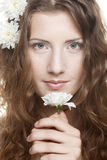 Woman face with white flowers Stock Images