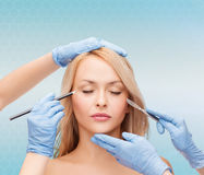 Free Woman Face With Hands Holding Marker And Scalpel Royalty Free Stock Photos - 46973578