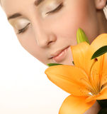 woman face with yellow lily flower Royalty Free Stock Image
