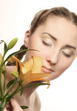 Woman face with yellow lily flower Royalty Free Stock Photo