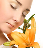 Woman face with yellow lily flower Royalty Free Stock Images