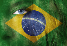 Woman face. Young beautiful woman face with intense blue eye and brazillian flag Stock Photo