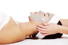 Woman with facial clay mask. Stock Photos