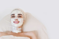 Woman with facial clay mask Royalty Free Stock Photo