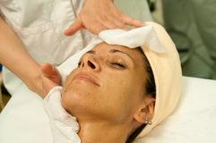 Woman facial cleaning. Beautician at work with a woman facial cleaning Royalty Free Stock Photos