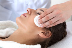 Woman during facial cleansing in spa royalty free stock photography